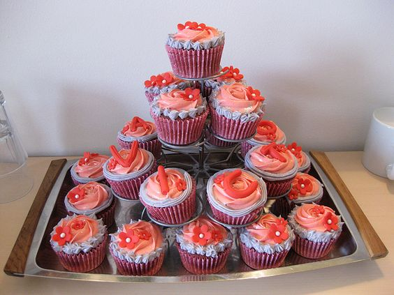 Red Velvet cupcakes w. pink and violet frosting and red fondant decorations. Served at my daughter's naming-celebration.