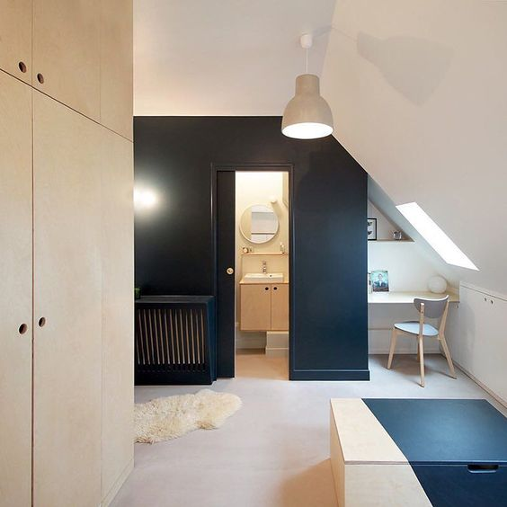 #BatiikStudio took a tiny #apartment and transformed it into a cool #modern space in #Paris. Before the renovation the attic with its slanted ceilings was dark and dated and now with the help of customized modular #furniture the #interior is highly functional and completely livable. See the before pics on designmilk.com \\\ Photo by @Bertrand.Fompeyrine by designmilk