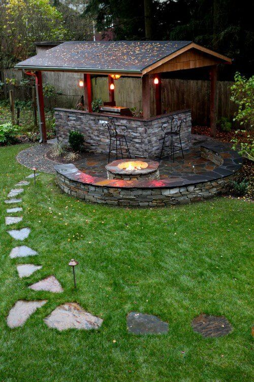 one side of this wood gazebo forms a stone l shaped bar area the grill fits snugly into one corner pergola fireplace pinterest bar areas - L Shape Garden Decor