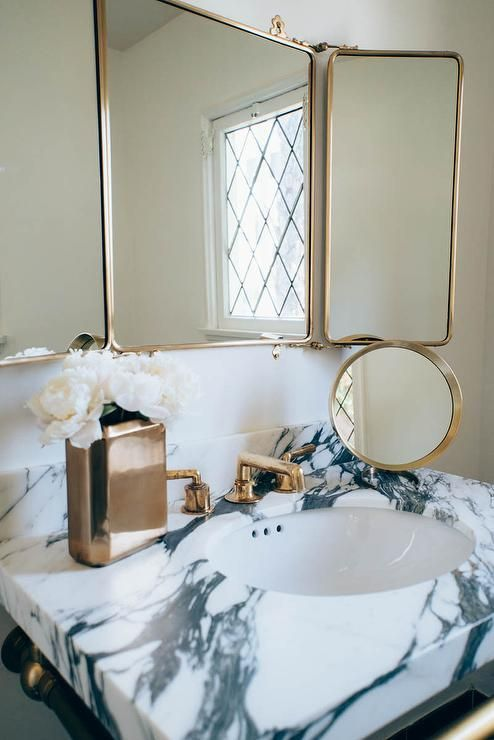 A Waterworks Daphne Metal Rectangular Wall Mounted Trifold Mirror Is Mounted Above A Marble Top Bath Bathroom Design Inspiration Trifold Mirror Bathroom Design