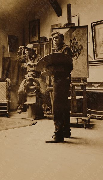 N. C. Wyeth in his studio with a model