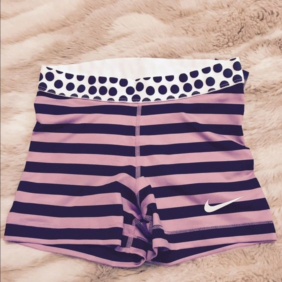 Nike dryfit shorts Lady's Nike dry fit boy short in black/purple strip and polka dot. Super cute under work out shorts. Never worn. Nike Shorts