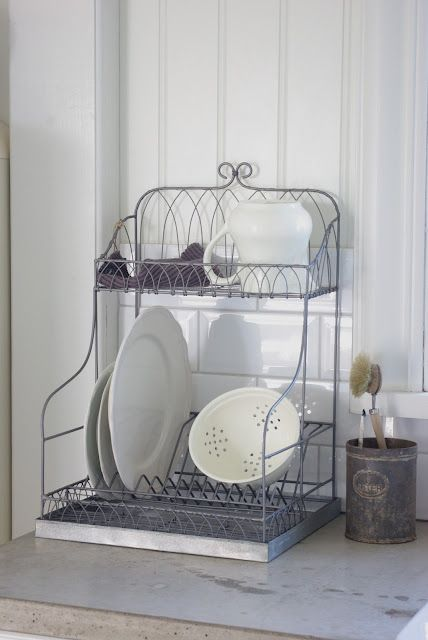 """dish rack. this one I have in one of my kitchen - but I´m not proud of it..to much """"created shabby chic, en masse"""", I think."""