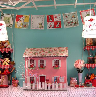 this doll house is cute as can be and it is made of felt which I love.