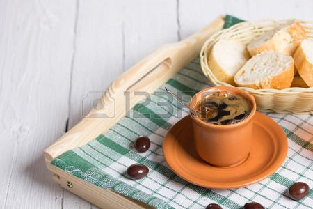 cup of coffee bread and sweets in a basket on a wooden tray Stock Photo