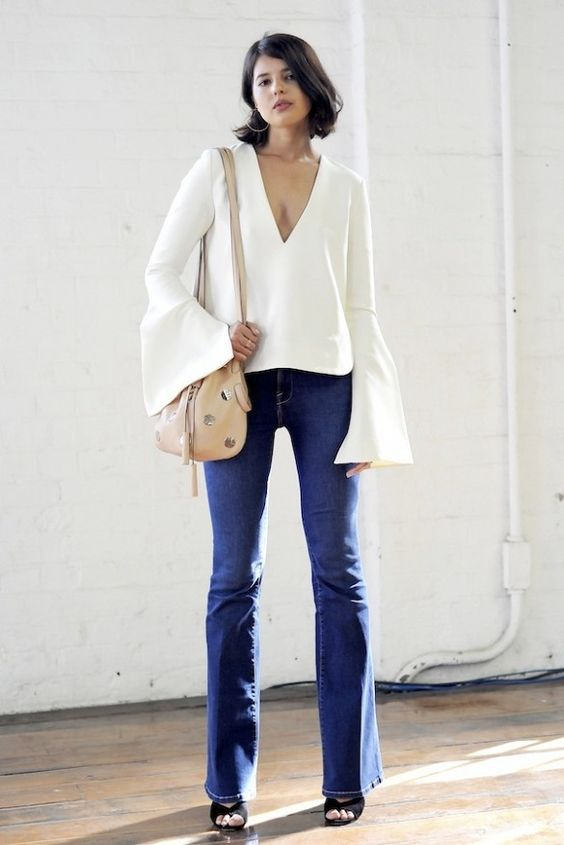 Talisa Sutton // bell sleeve top, embellished bucket bag & flared jeans: