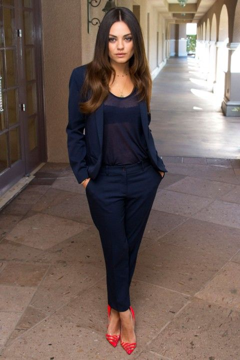 Mila Kunis in a midnight blue trouser suit and top at a press