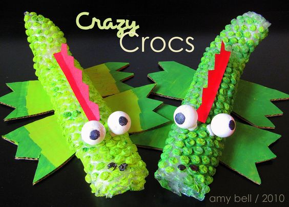 How cool!  Wrap paper towel rolls with bubble wrap...and voila!  Some very textured crocodiles!
