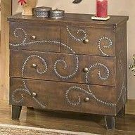 furniture tacks hammered into an old dresser (I think I could actually do this, no scrolly girly pattern- geometric instead)