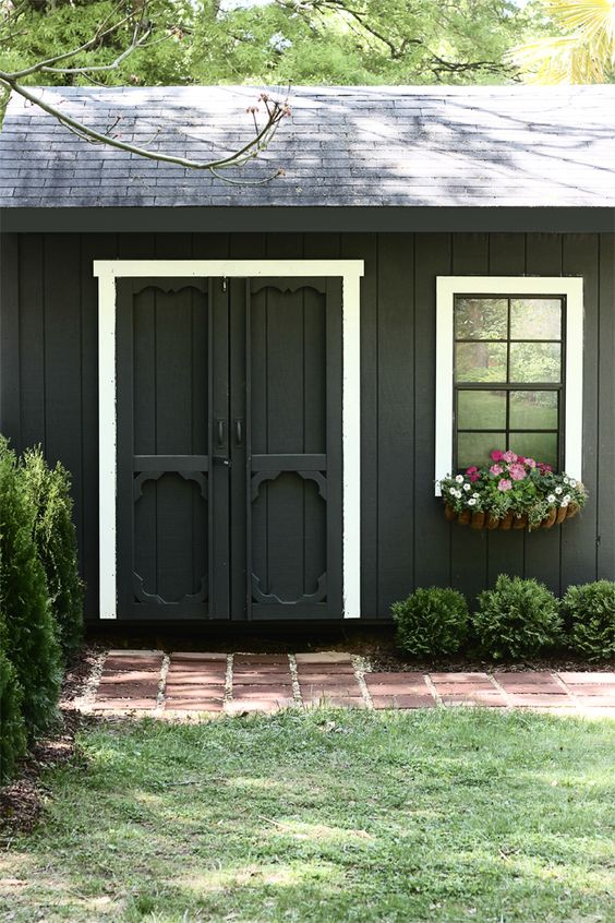 The hunted interior she painted her shed black for Garden shed interior designs