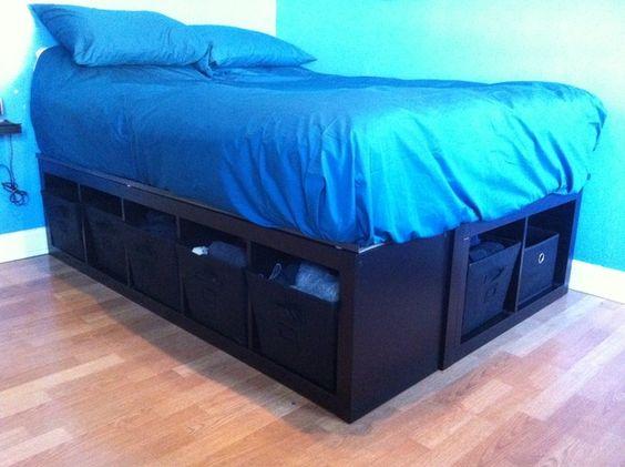 IKEA Hackers: EXPEDIT Bed Frame Materials: (2) EXPEDIT 5X1 Shelving unit's, FIXA floor protectors, (2) sheets MDF, (1) 4X4 post, wood screws, power drill