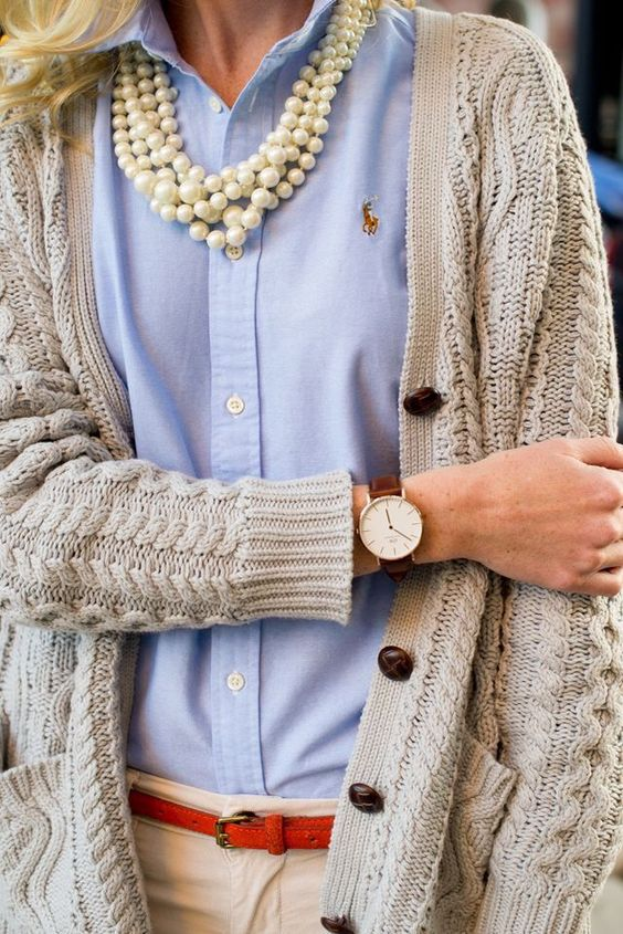 Pearls layered over a button down with a cable knit cardigan.