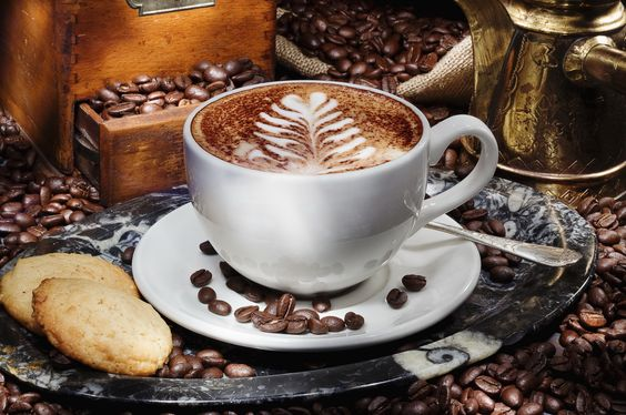 White cup of coffee - full of beans in the background. Food and cooking, Delicious Wallpapers. HD Wallpaper Download for iPad and iPhone Widescreen 2160p UHD