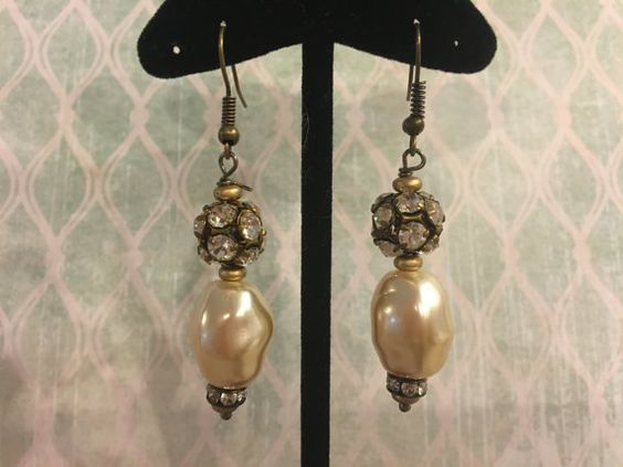 These beautiful earrings feature vintage Swarovski crystal balls at the top followed by lovely vintage Czech glass pearls. These Miriam Haskell style pearl drops are dimpled and beautiful. These would be lovely for a wedding. Convo me with questions or for special orders.