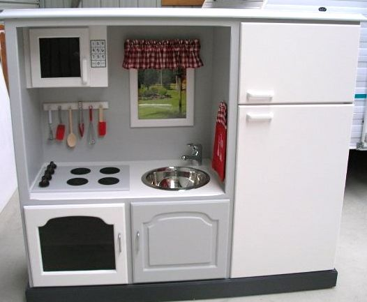 entertainment center turned play kitchen. reduce, reuse, recycle :)