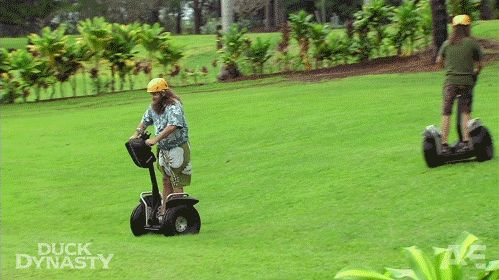 A GIF of Willie Robertson falling off of a segway