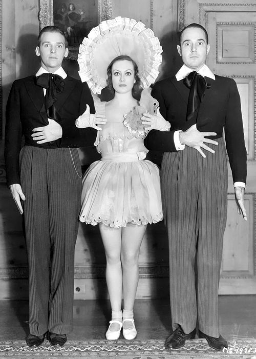 "Douglas Fairbanks, Jr., Joan Crawford, and William Haines strike a comic pose while attending a Marion Davies ""baby doll"" party, 1932:"