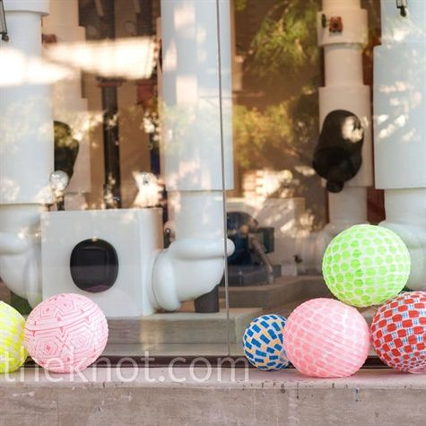 Dara and Rob decorated around the air-conditioner fixtures using bright patterned paper lanterns.