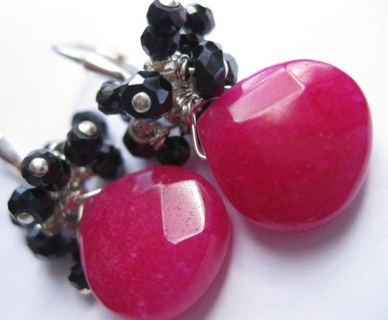 What sparkle, what color, what a blast from the past! These hot pink/fushia/magenta stones combined with glittering black are a classic combination right out of the punk rock era!    Two gorgeous hot pink jade briolettes are paired with an explosion of black garnets to give this classic design a rocker-babe twist!    Stones are wrapped entirely in sterling silver, and hang from sterling silver leverback earwires. They are aprox 1 3/4 inch from very top of earwire. Stones are 12x10mm.