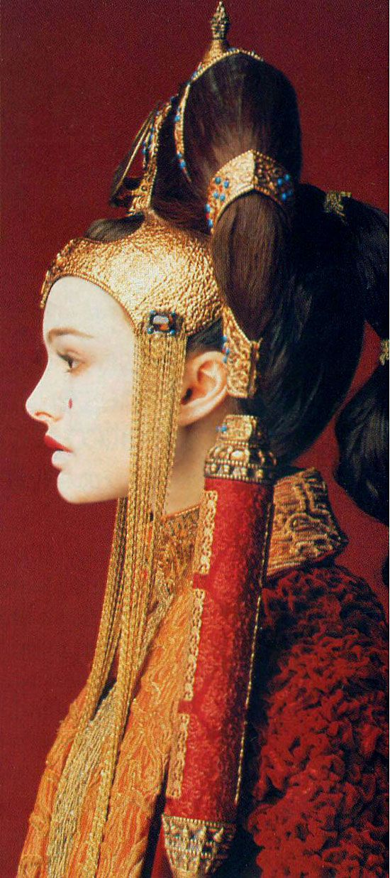 Amidala... her hair! How does she do it. If I were the Queen of my planet, I wouldn't have time to do my hair like that!: