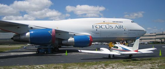 My Piper Twin Comanche parked next to a Boeing 747 @ Ft Lauderdale Florida