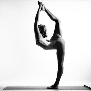 @nude_yogagirl's black-and-white photography and intricate poses are giving us goosebumps. #regram #yoga'