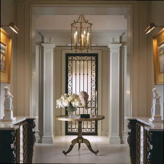 brilliantly decorated foyer this white black gold colour scheme includes a french round table brilliant foyer chandelier ideas