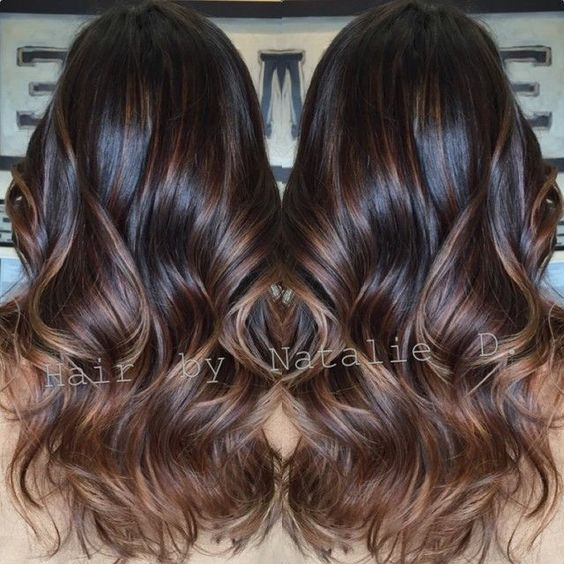 Dark brown balayaged hair.