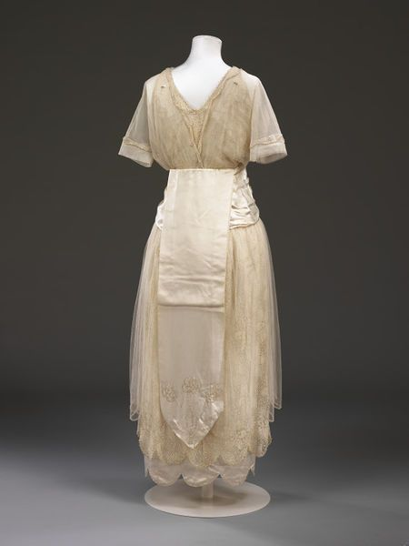 1914, England - Wedding dress by Aida Woolf - Silk satin, glass beads embroidered on net, lace lined with tulle