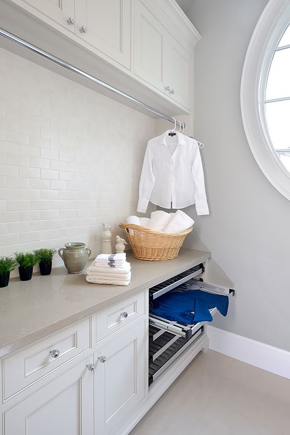 laundry room hanging rod with white shirt