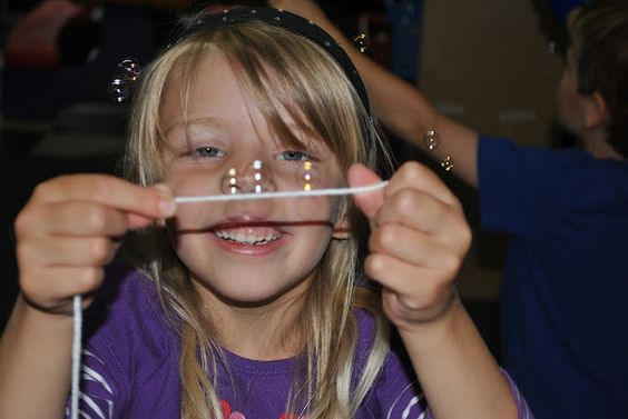 Wonderful visual tracking and coordination activity.  So simple. catching bubbles on string