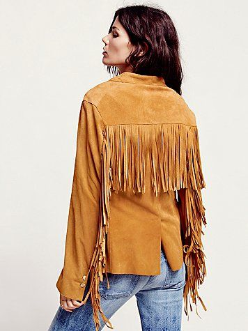 Bohemian Tribal Style: Caramel suede jacket features fringe on the sleeves and back and Lace up ties on sides.