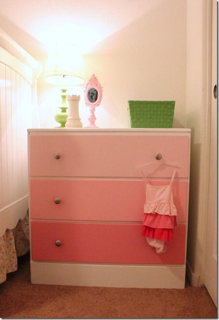 Refinished dresser with multi colored drawers.