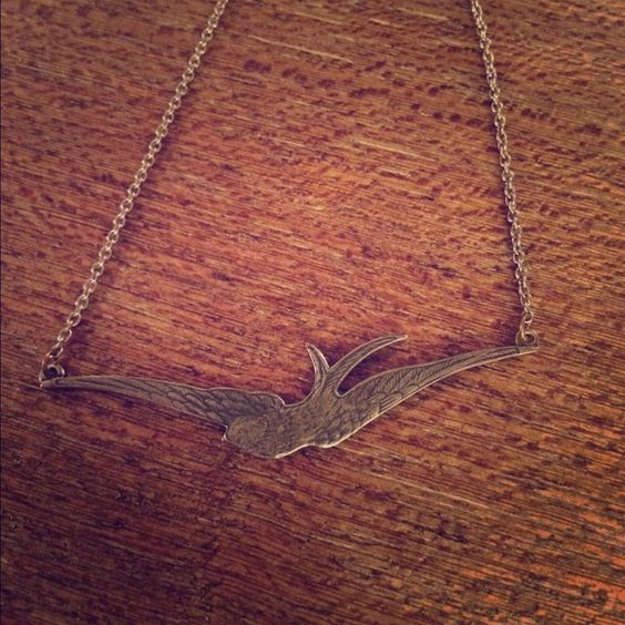 Silver Bird Necklace Adorable silver flying bird necklace. Great for layering or worn alone. Rests just below collar bone (as seen in picture). Jewelry Necklaces