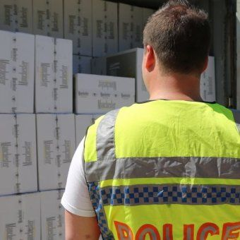Police in New South Wales say they have shut down a crime syndicate responsible for distributing millions of dollars in illicit tobacco and drugs. Waterfront officials were among those charged after the drugs arrived from the United Arab Emirates.