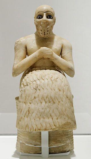 Statue of Ebih-Il, superintendent of Mari Material: Gypsum, schist, shells, lapis lazuli. c. 2400 BC