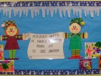 winter bulletin board with colorful presents and elves