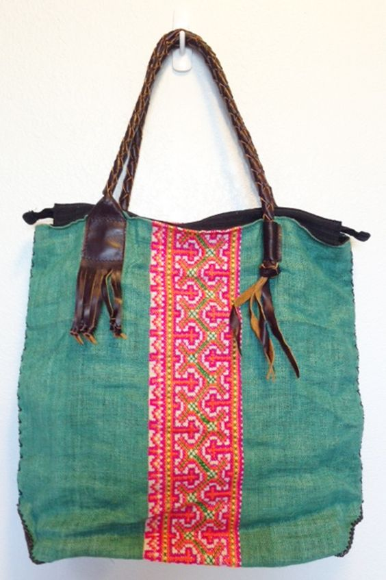 """Made from hemp and vintage fabrics. Pop colored lining with interior pocket.Straps are 100 % leatherMeasurements 15 x 15 1/2"""" x 3 3/4"""" baseStrap 17 1/2"""""""