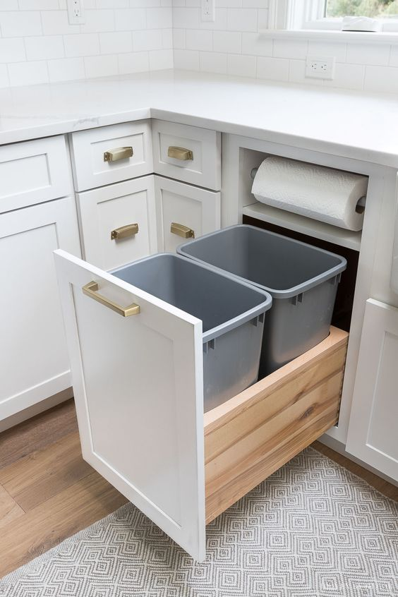 Kitchen garbage pull-out with built-in paper towel holder - a must-have for my kitchen renovation! #kitchendesign #kitchencabinets #kitchenorganization #kitchen #kitchens #kitchenstorage #kitchenstorageideas #kitchendecor #kitchendesignideas #kitchenremodel #kitchenrenovation
