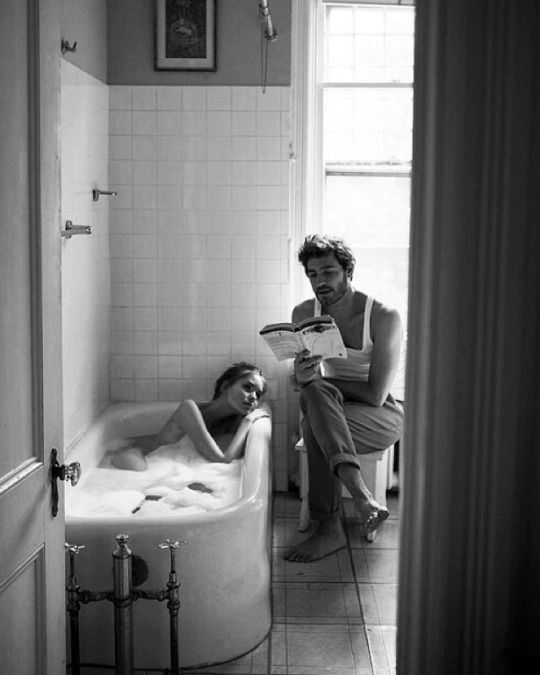 The couple that reads together, stays together. Even if only one of them is in the bathtub