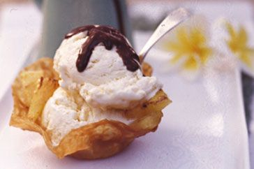 Pineapple wafers with ice-cream and chocolate sauce main image
