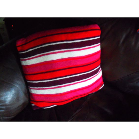 Stripy knitted cushion cover, using stocking stitch
