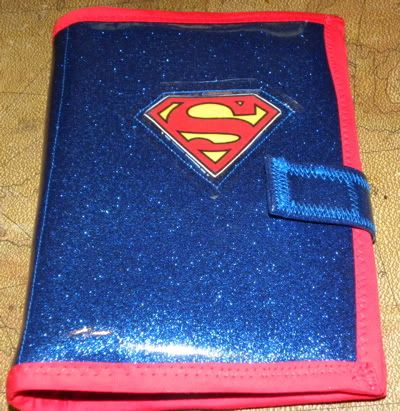 iPad cover I made for a friend of mine. Outside is blue glitter vinyl, inside is padded and lined with superman fabric. Click for more pics