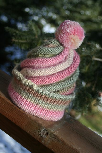 Free knitting pattern Swirled Ski Cap pattern by Caps for Kids with pompom. Designed by Caps for Kids, this cap comes in 2 sizes. Knit flat from side to side, increases on one side and decreases on the other turn vertical stripes into swirls when the cap is seamed. Great for multi-color yarn!