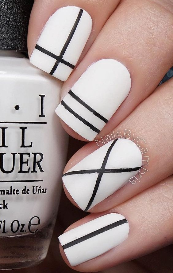Another minimalist design using matte white nail polish and matte black stripes. Again, using strips of tape will do the job. Just make sure the base color is completely dry before you place the tapes.