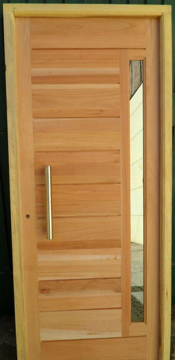 Puerta de madera en cedro con barral y vidrio for Puertas de entrada con vidrio