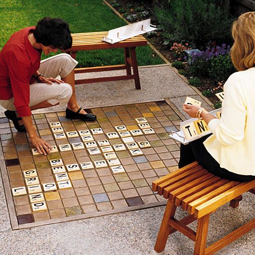 DIY Backyard Scrabble: The 5 foot square board doubles as a poured concrete patio floor. The letter tiles were made from adhesive backed vinyl letters stuck onto squares of baseboard trim and then sealed with spray lacquer! #DIY #Backyard_Projects #Scrabble: