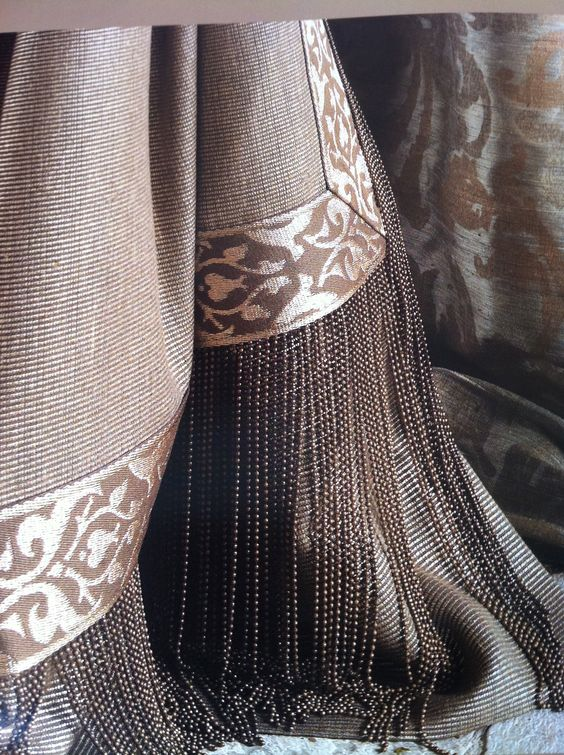 Puddled drapes & details in lovely palette. Amazing micro-beaded fringe!: