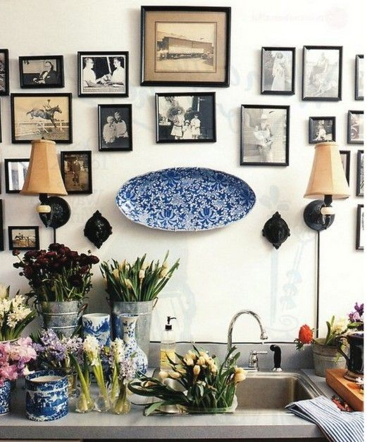 i love the mix of art, flowers, the lovely plate...