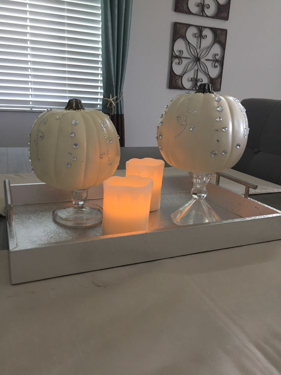 Pumpkins are all bling- ed out for the holidays.